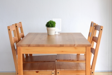 designer chair: Wooden dining table for 4  Stock Photo