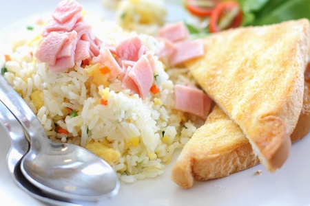 Fried rice with ham, served with toast photo
