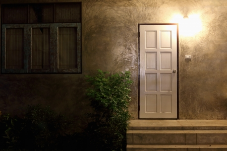 Entrance of a house at night Stock Photo