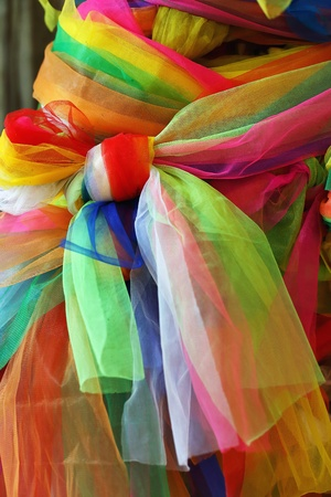 processed: Colorful fabric tied to a tree