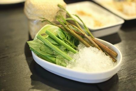 soak: Fresh vegetables soak in the ice Stock Photo
