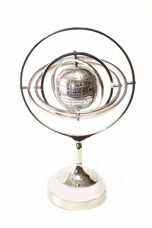 Globe model in the silver case on a white background photo