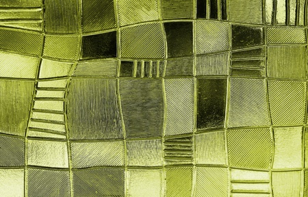 diagonals: stained glass window with irregular block pattern in a hue of gold, square format