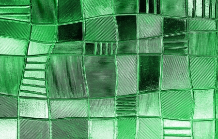 stained glass window with irregular block pattern in a hue of green, square format photo