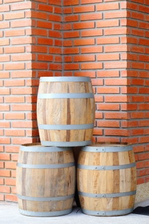 beer barrel: Large wine barrels on Red brick wall Stock Photo