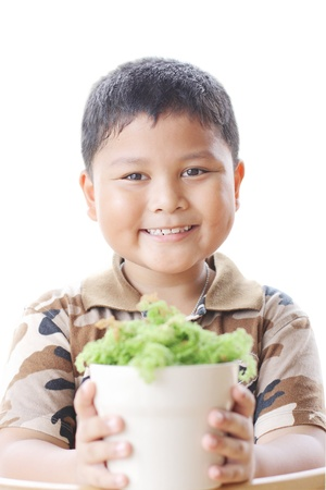 The boy is happy. With small trees. Stock Photo - 22022291