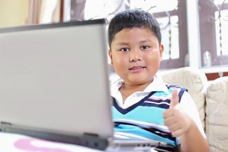 Asian boys. Playing laptop photo