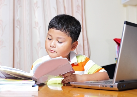 Asian boy work homework carefully. photo