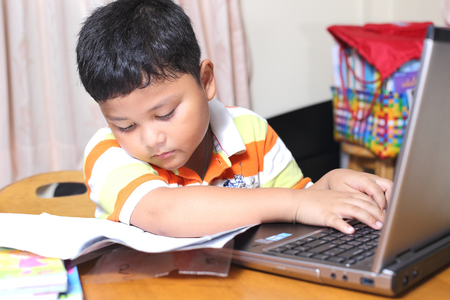 Asian boy work homework carefully. Stock Photo