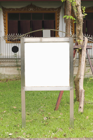 conceptional: Here is a sign in the park without any words, which allow user to put own words on it. Stock Photo