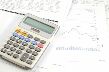 Finance statement with calculator photo