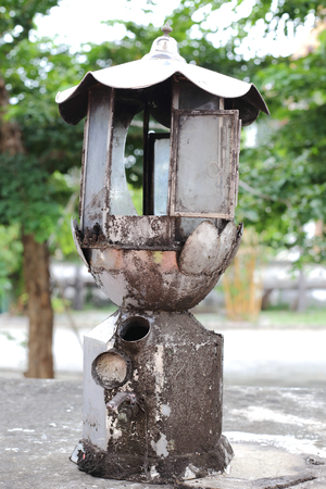 Old oil lamp with a state of disrepair