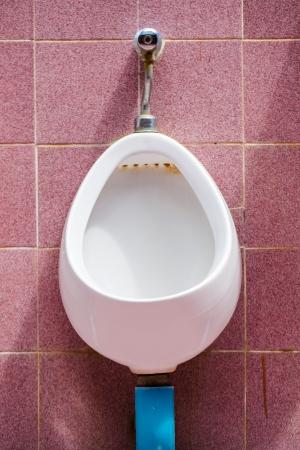 white porcelain urinals photo