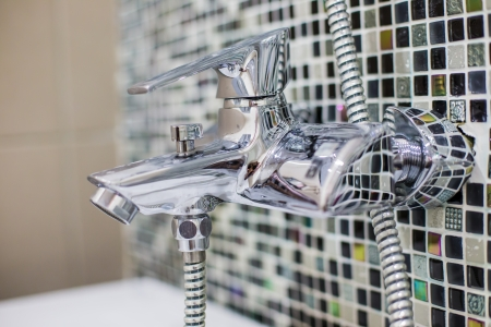 Stainless steel kitchen faucet and sink photo