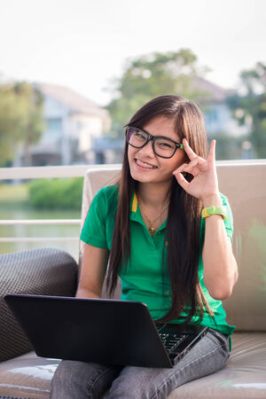 Pretty Asian female adolescents use technology for communication photo