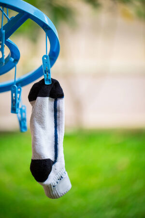 white sock on washing line with wooden clothes peg and bubbles photo