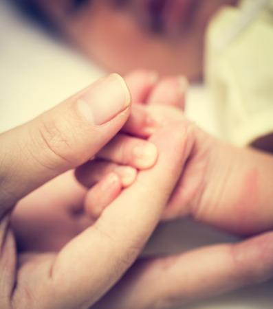 neonate: New born baby hand Stock Photo