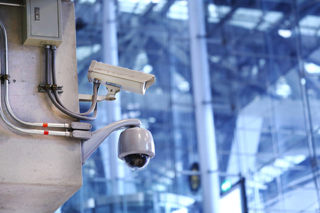 private security: CCTV cameras in the airport.
