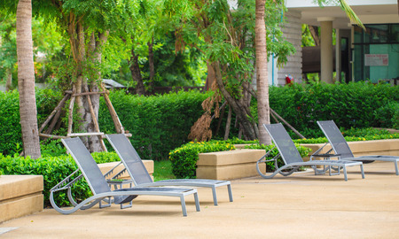 Poolside loungers at an exotic asian hote photo