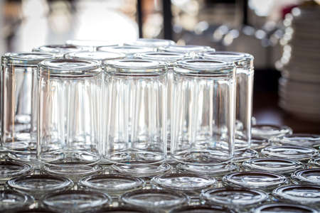 Row of water glasses on the table photo