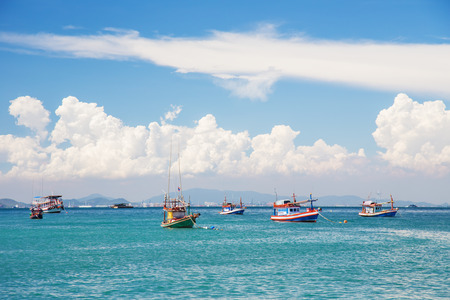 Fishing boat in the sea And the beautiful sky photo