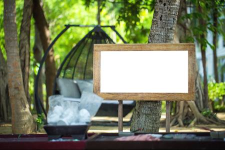 wooden sign in summer forest, park or garden photo