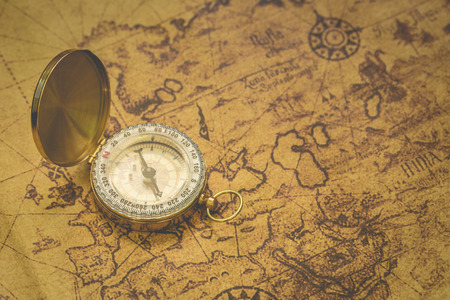 compass rose: Old compass on vintage map. Stock Photo
