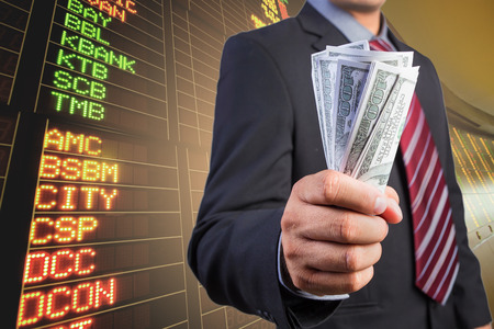 us money: Businessman hand gripping money, US dollar (USD) bills - investment, business concepts