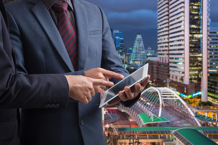 touchpad: Businessmen using touchpad,,Investment concept Stock Photo