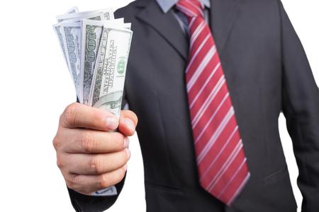 Businessman hand gripping money, US dollar (USD) bills - investment, business concepts