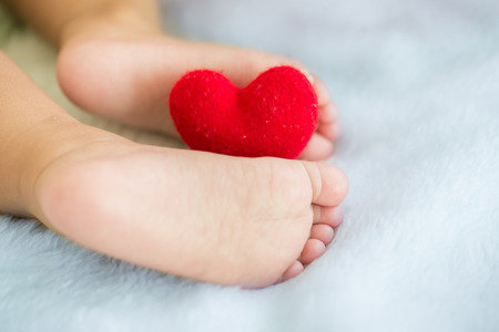 baby's feet: babys feet with a red heart