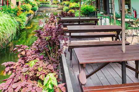 lush: table set in lush garden