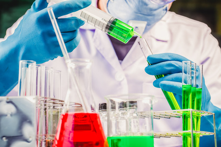 Hands of clinician holding tools during scientific experiment in laboratory,MERS Stock Photo