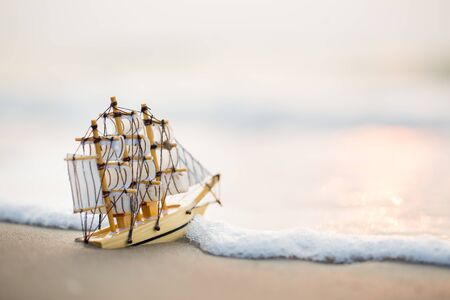 Sailing ship model on the beach, discovery concept