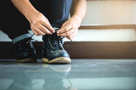Men wearing work black boot.