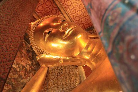 Close up big golden budhha statue in Wat Pho,Bangkok Thailand Stock Photo