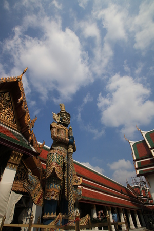 The big giant,beuautiful building and white cloud blue sky in wat phra keaw,Bangkok Thailand