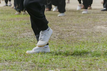 Children wear gym shoes on the field. Фото со стока