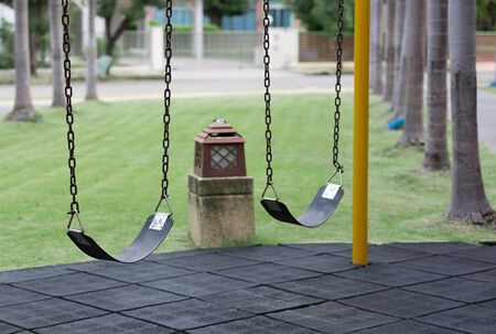 rubber sheet: empty chain swing Stock Photo