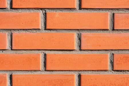 A close up of a brick building. background section of brick wall orange macro. part of brick wall.