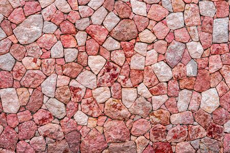 Purple and pink marble stone wall texture background. Closeup surface grunge stone texture, stonework rock old pattern clean grid uneven bricks design stack