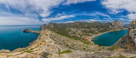 Beautiful seascape, panorama of cape Kapchik to the Galitsin Trail and blue bay of the Black Sea. Sudak, New World. Landscape of the sea coast. The concept of calmness, silence and unity with nature