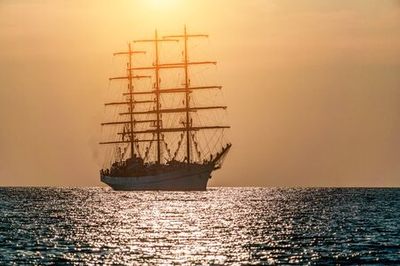 Seascape with sailing ship. White sailing vessel floating in the sea