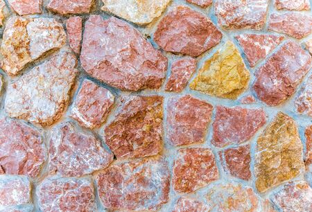 Pink marble stone wall texture background. Closeup surface grunge limestone texture, stonework rock, old pattern clean grid uneven bricks design stack.