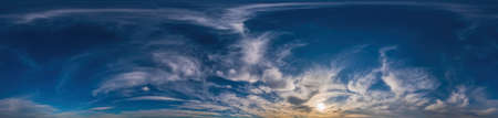 Sunset sky panorama with Cirrus clouds in Seamless spherical equirectangular format. Complete zenith for use in 3D graphics, game and for composites in aerial drone 360 degree panoramas as a sky dome