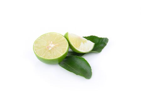 scurvy: Green Lemons cut pieces isolated on white background.