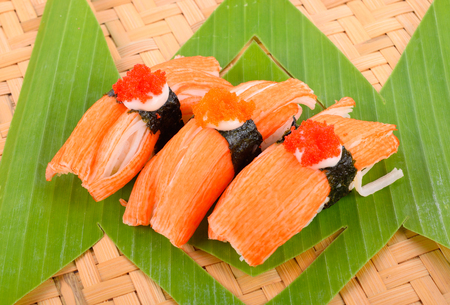 knew: Crab crab sushi pieces on a wooden floor. Stock Photo