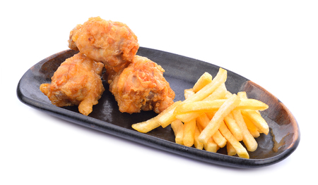 Fried chicken and French fries on a white background. Stock Photo