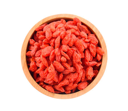 Goji berries in a bowl on a white background