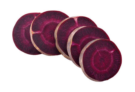 Fresh purple carrots isolated on a white background